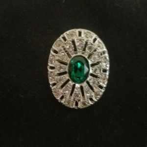 Faux emerald and diamond brooch
